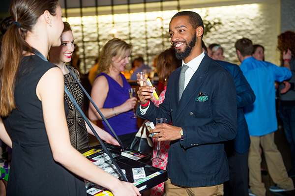5_Kevin Gray of Men's Style Point selects a candy cigar